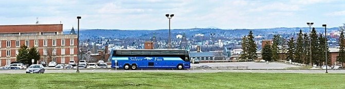 Silver Fox Holy Cross College Charter Bus